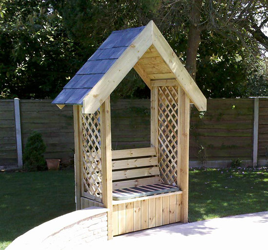 hand built arbour with slate roof